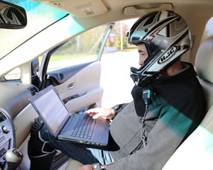 Mark with laptop in a car